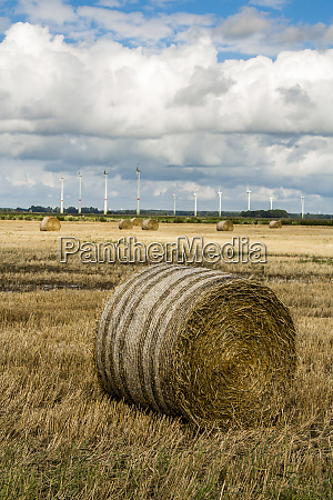 hay bales wind turbines agriculture in
