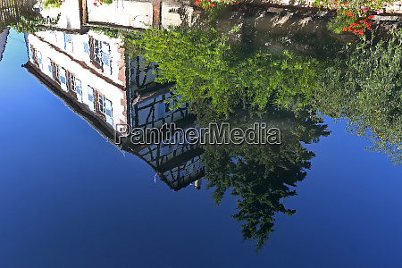 water reflection half timbered house