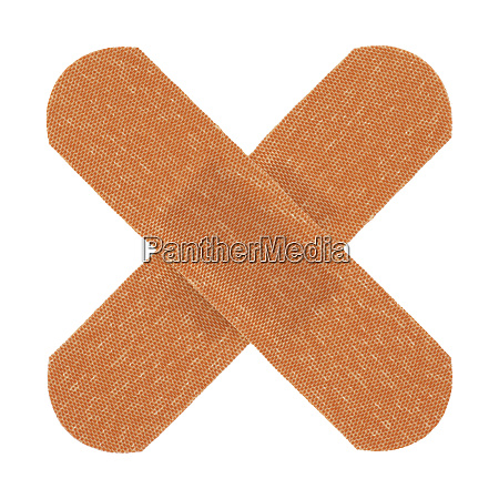 medical plasters cross in white with