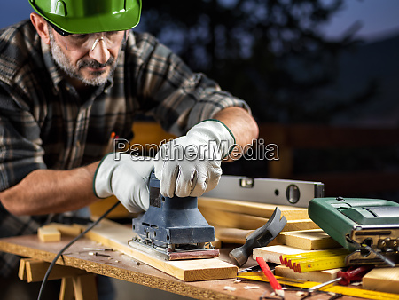 craftsman at work on wooden boards