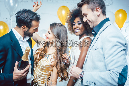 party people with drinks celebrating new