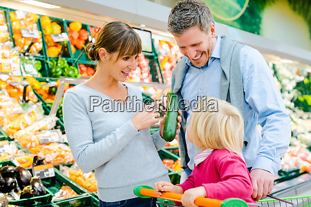 family shopping fruit and vegetables in