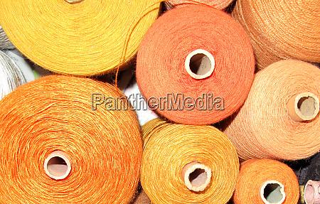 weaving yarn in yellow and orange
