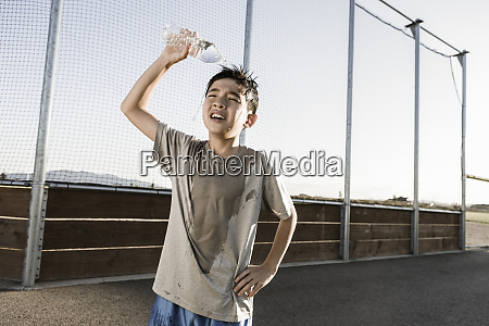 boy cools off after practice