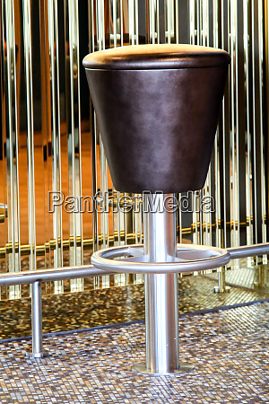round metallic leather covered bar stool