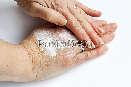 a woman rubs her hands with
