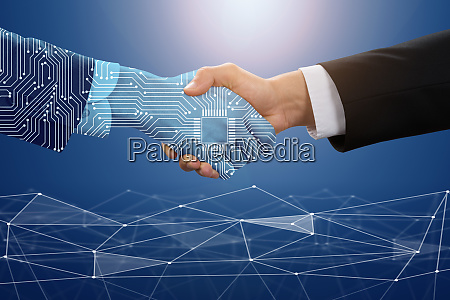 businessman shaking hands in front of