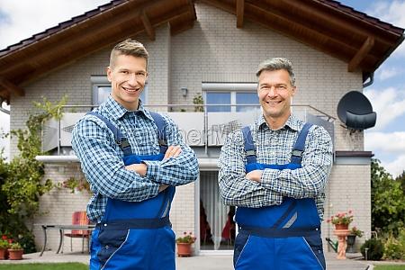 smiling portrait of two male handymen