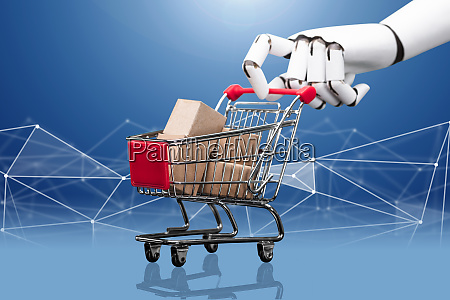 robotic hand holding shopping cart filled