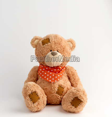 brown vintage teddy bear with patches