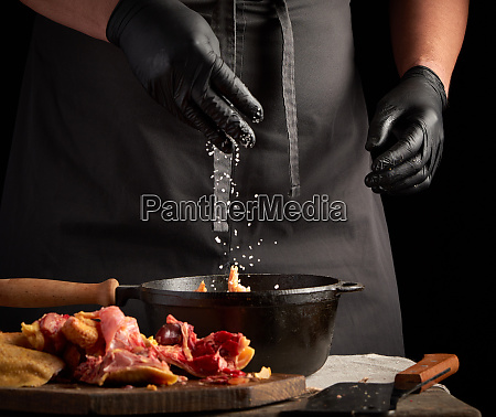 chef in black uniform and latex