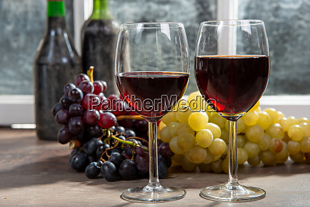 composition with two wineglasses grapes and