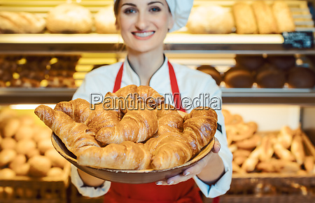 sales woman offering fresh pastries