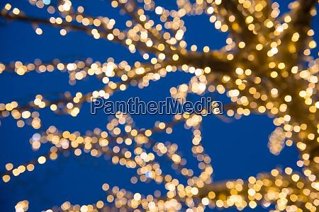 blurred golden lights on christmas tree