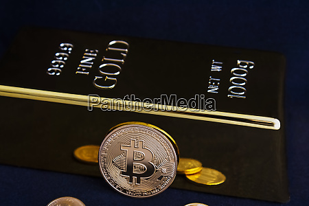 bitcoin cryptocurrency and gold bar on