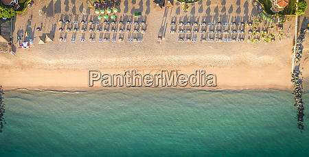 aerial view of coastline beach umbrellas