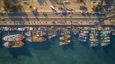 aerial view of wooden boats moored
