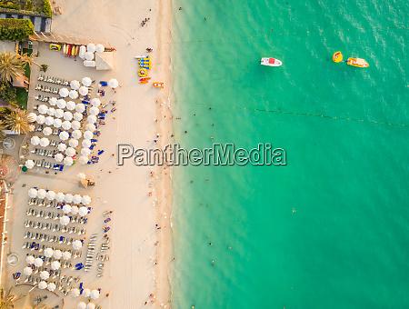 aerial view of people enjoying turquoise
