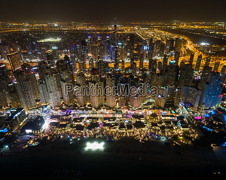 aerial view of illuminated skyscrapers in