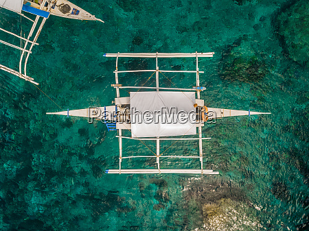 aerial view of white boat with