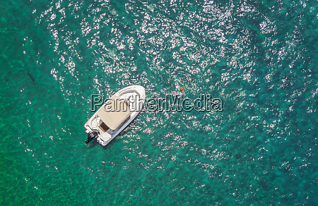 aerial view of small boat anchored