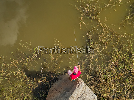 aerial view above of man fishing