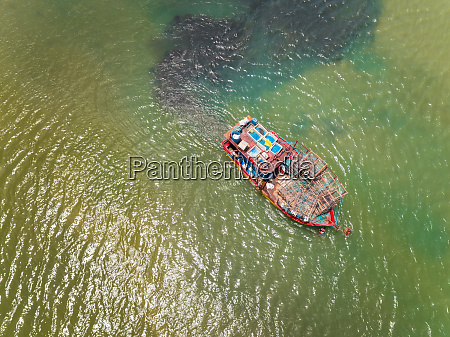 aerial view of fishing boat navigating