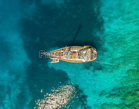 aerial view of boat anchored between