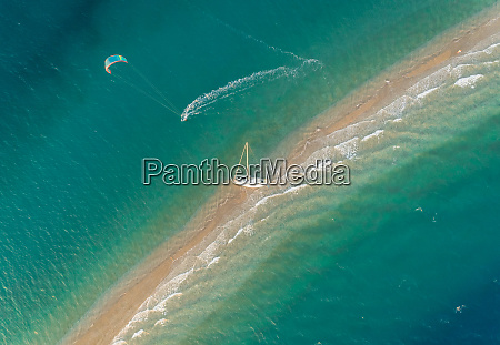 aerial view of person practicing windsurfing