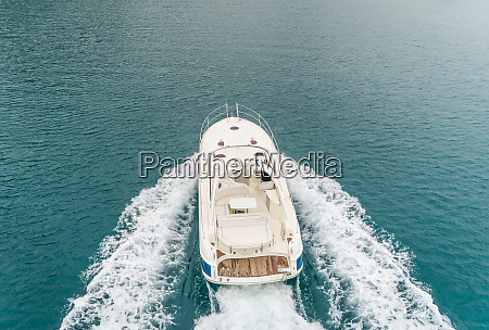 aerial view of boat speeding to