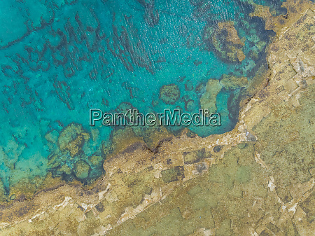 aerial view of shore and rock