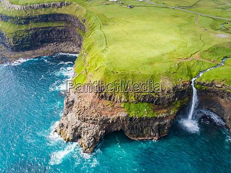 aerial view of mulafossur waterfall ending