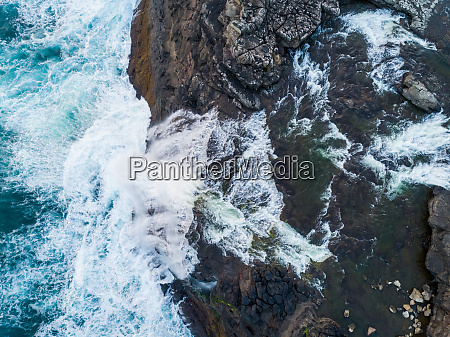 aerial view of water encountering agitated