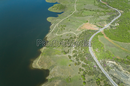aerial view of windy road beside