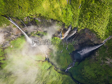aerial view above waterfall surrounding by