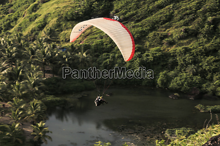 aerial view of two guys paragliding