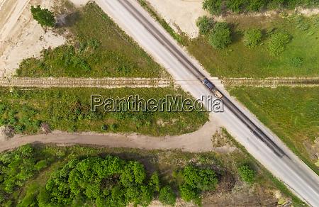 aerial view road going through train