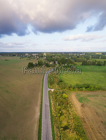 aerial view road going through field