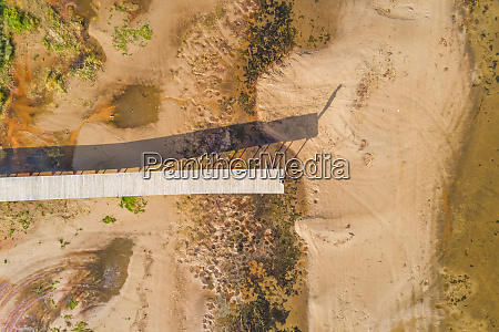 aerial view of long wood pier