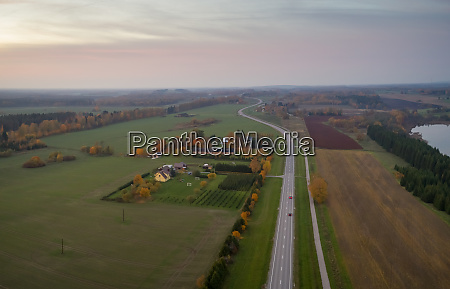 aerial view of road crossing agricultural