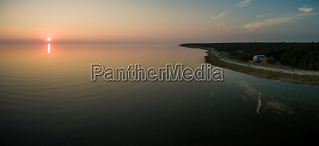 aerial view of coastline at sunset