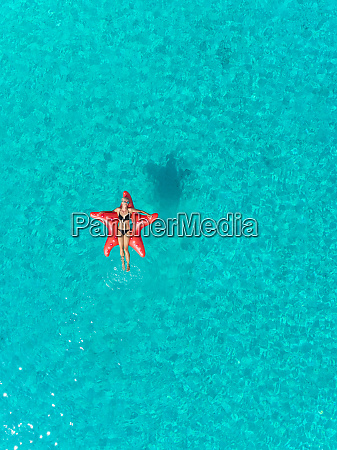 aerial view of one woman floating