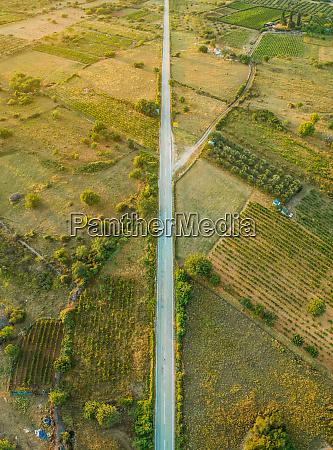 aerial view of long road in