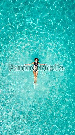 aerial view of a woman floating