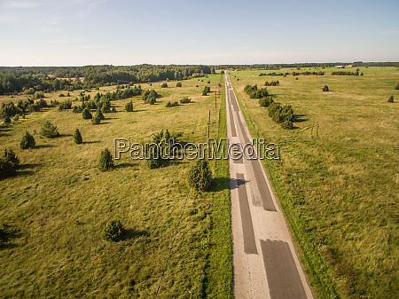 aerial view of straight road in