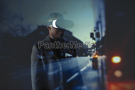 double exposure businessman with virtual reality