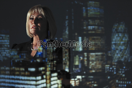 double exposure thoughtful businesswoman against highrise