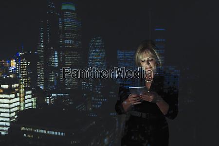 double exposure businesswoman using digital tablet
