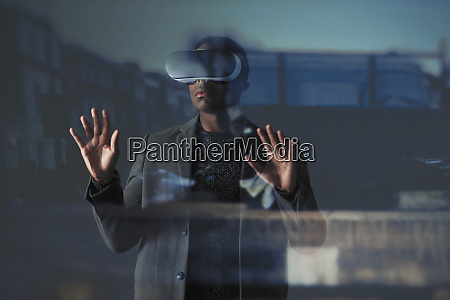 double exposure businessman using virtual reality
