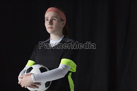 portrait confident ambitious teenage girl soccer